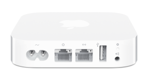 This is the AirPort Express, initially a small wireless router, but it can be configured to extend a wireless network, act as a printer hub, or become a dedicated AirPlay audio receiver.